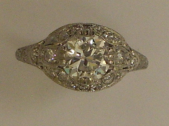 Platinum Ring With Diamond & Bead Setting