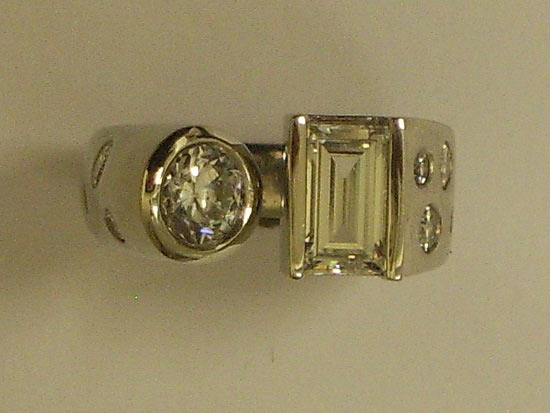Platinum Round & Emerald Cut Diamond Ring