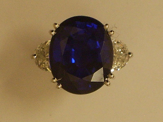 Oval Sapphire with Trillion Diamonds next to it