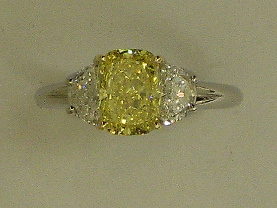 Platinum Ring With White Diamonds & An Intense Fancy Yellow Diamond