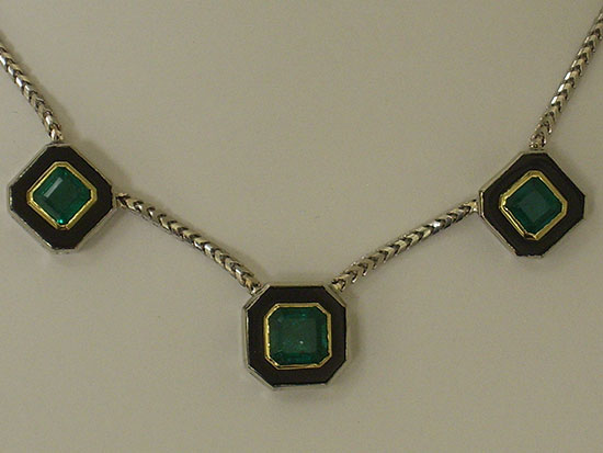Emerald, onyx, and gold necklace
