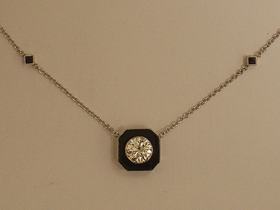 White Gold Chain With a Diamond Set Into Black Onyx