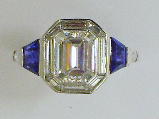 Platinum ring with Emerald cut diamond and bullet shaped Sapphires